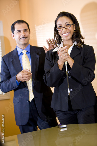 Successful female office worker getting pat on back from manager