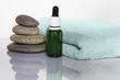 pyramid of pebbles,  towel and aroma oil