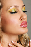 Fashionable young woman with vibrant makeup poster