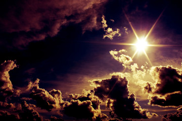 Alien sky with dramatic sun and clouds