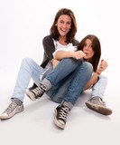 Mother and teenage daughter fooling around poster