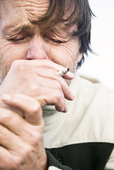 depressed lonely man crying with cigarette