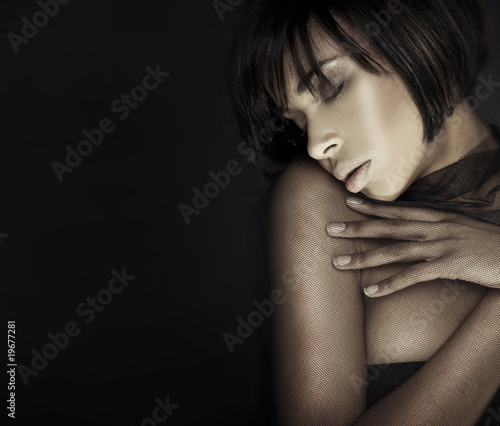 Headshot brunette woman with her eyes closed