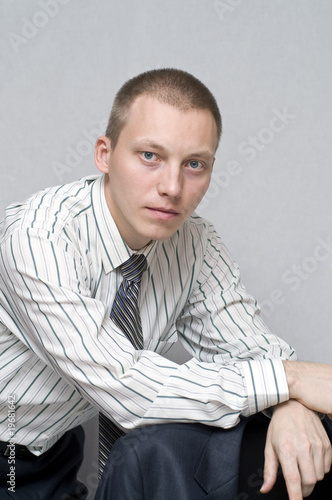 Young businessman looking thoughtfully into the distance.