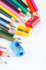 crayons and sharpeners on white background