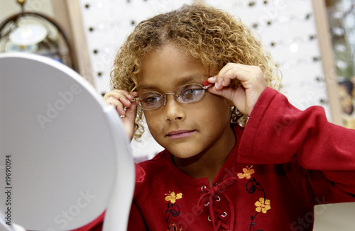 African American girl trying on glasses