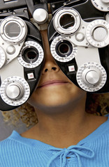 African American girl getting eye exam