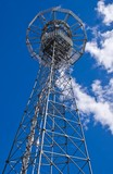 Telecommunication tower against blue sky poster
