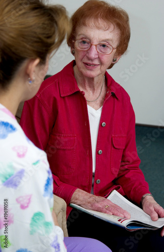 Nurse talking with senior woman