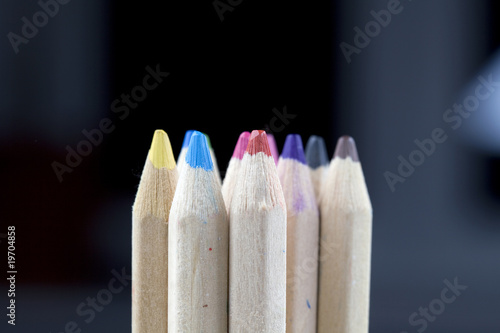 Assorted wooden, colour pencils in vibrant tones