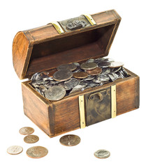 Wooden chest overfilled with coins