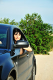 woman driving a car outdoors poster