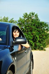 woman driving a car outdoors