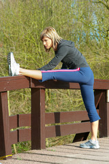 Sportswoman Lunging Outdoors.