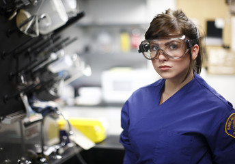 A sexy young criminologist in a lab.
