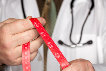Doctor with Stethoscope Holding Measuring Tape