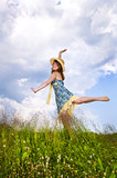 Young girl dancing in meadow