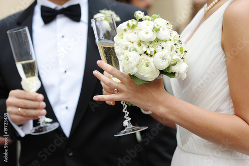 Bride and groom holding champagne glasses
