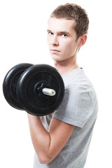 Concentrated young man lift weights