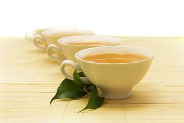 white cups of tea