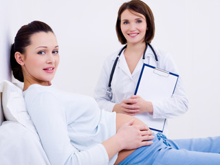 Beautiful pregnant woman with the doctor