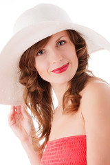 Romantic young woman in white straw hat