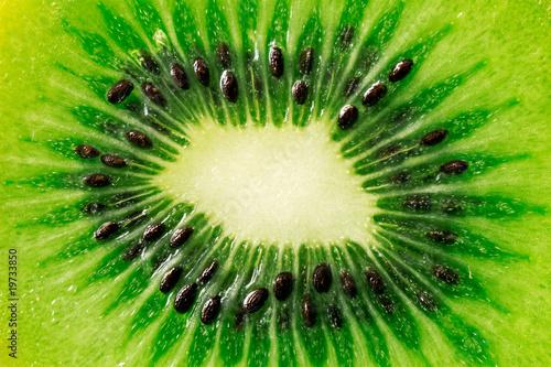 close up slice of juicy kiwi fruit