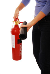 Woman holding fire extinguisher