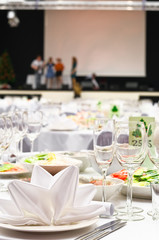 Details of a wedding banquet with stage and artists on it