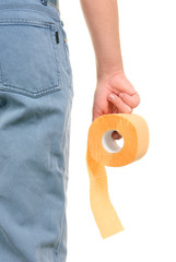 Roll of yellow toilet paper in hand