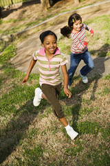 Young Girls Running on Grass