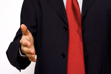 businessman giving an hand to clasp