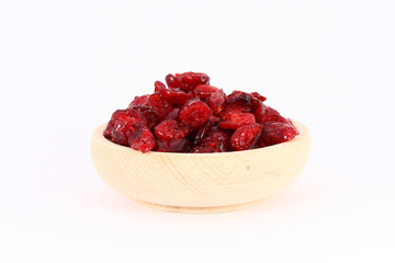 Dried cranberries in wooden bowl