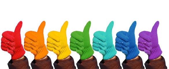 Hands in rainbow gloves show gesture ok on white, collage