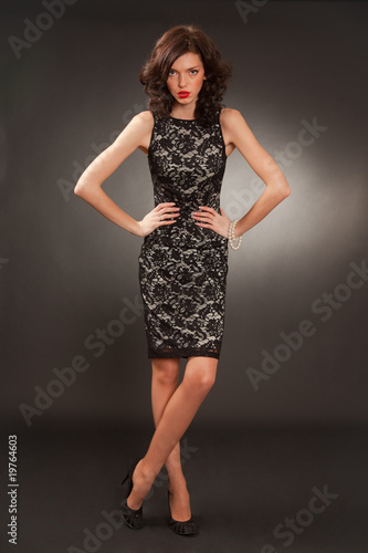 Posing girl in transparent stylish dress