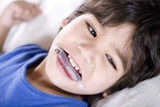 Disabled boy wearing a mouth guard poster