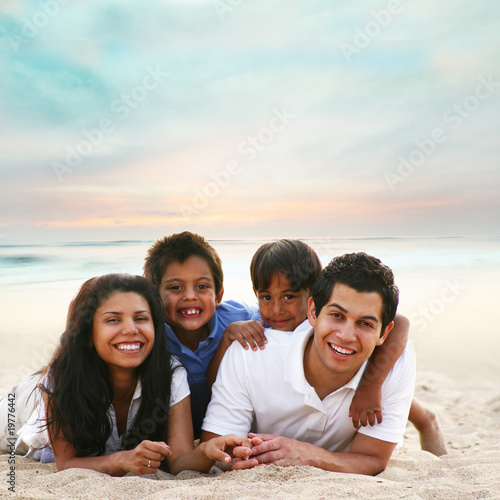 Family sunset portrait at the beach