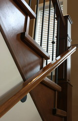 Custom designed staircase, wrought iron and stained oak