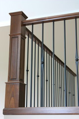 Bannister with wrought iron and beautiful stained oak