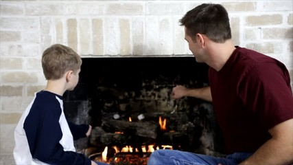 Dad Roasting Marshmallows with His Son