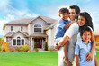 Happy family portrait in front of house