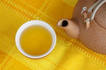 A cup of tea with a tea-kettle