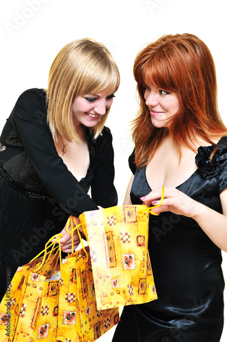 two curious shopping girls