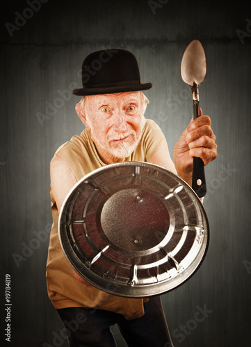 Senior defending himself with spoon and can lid