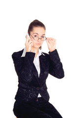 business woman in glasses talking on mobile phone