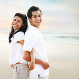 Happy  Carefree Couple Portrait at the Beach poster