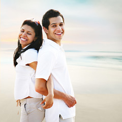Happy  Carefree Couple Portrait at the Beach