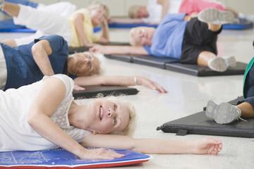 Women on exercise mats