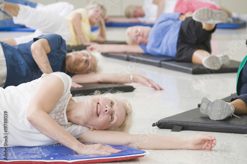 Women on exercise mats