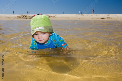 Baby swimming at beach